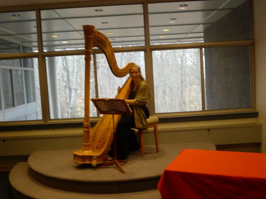 Harpist Merynda Adams played at Betsy Mirabelli's opening reception.